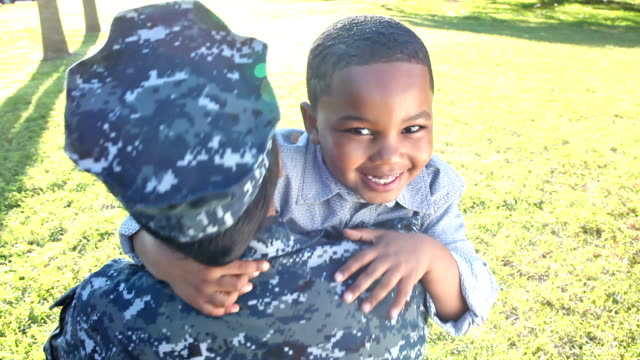 Female US military soldier reunites with son video