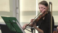 HD: Female Violinist Playing In Music Class video