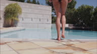 Female walking in the swimming pool video