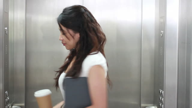 Female walking into elevator video