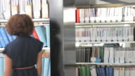 Female walking into library video