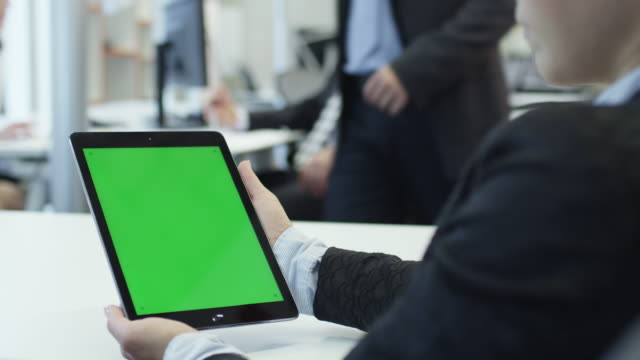 Female Woman Worker is Holding Tablet with Green Screen. Great for Mockup Usage. video
