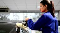 Female worker polishing a car video