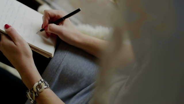 Female Writing on Notepad With a Pen video