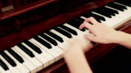 Female's hand playing a piano video