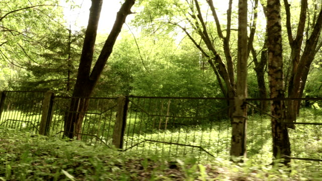 Fence of the kids abandoned camping. Smooth and slow steady cam shot. video