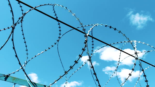 Fence with barbed wire. Closed territory protection video