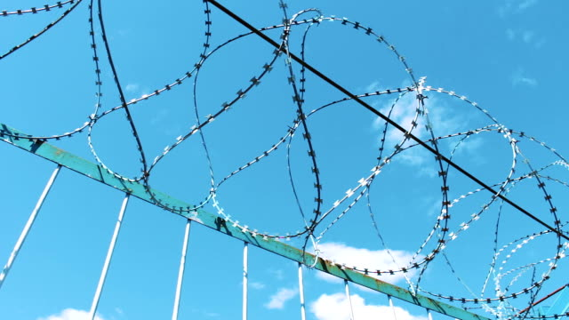 Fence with barbed wire. Fencing of the territory. Prison enterprise. Prohibition of visiting the territory. Security, unauthorized entry is prohibited video