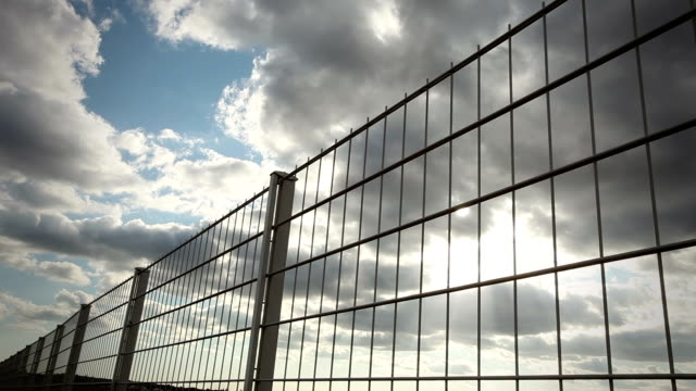 fence with clouds - time lapse video