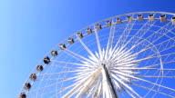 Ferris wheel against blue sky video