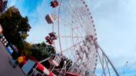 Ferris wheel at an amusement park. Rotation shot video