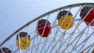 Ferris wheel close up spinning around. Amusement park video