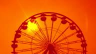 Ferris wheel. Dreamy orange sunset. video