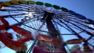 Ferris wheel in an amusement Park with sunlight in action. video