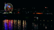 Ferris wheel reflection in river at night video