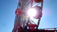 Ferris wheel spinning over the sun video