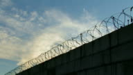 Ferro-concrete protection with a barbed wire. video