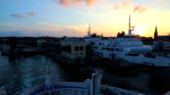Ferry departs from the pier at sunset video