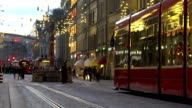 Festive atmosphere in decorated old city downtown, people go shopping for gifts video