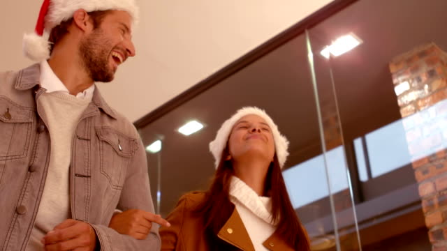 Festive couple going shopping together video