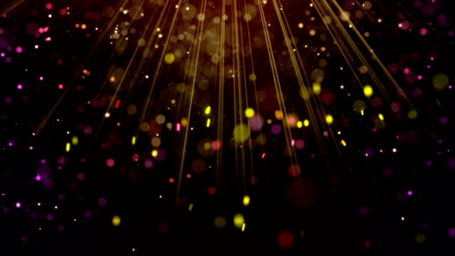 Festive glitter particles falling in light rays loop video
