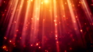 festive glitter particles in light rays loopable background video