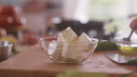 Feta cheese with sprig of spices and herbs video