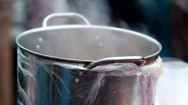 Field kitchen outdoor pan smoking, food prepared, steam rising video