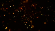 Fiery glowing particles falling down seamless loop video