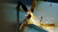 A Fiery Stream of Gas Wlder Cut a Metal Scrap video