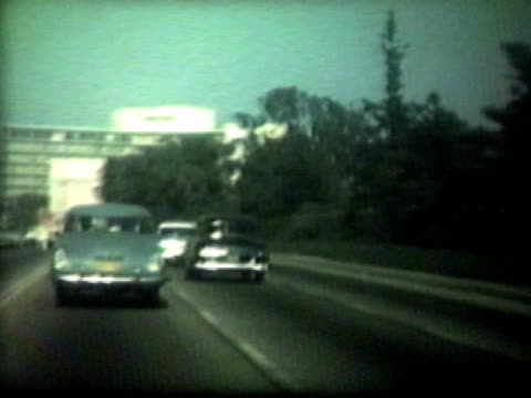 Fifties cars on highway-From 1950's film video