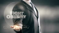 Fight Obesity Businessman Holding in Hand New technologies video