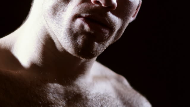 Fighter removes his mouthguard. video