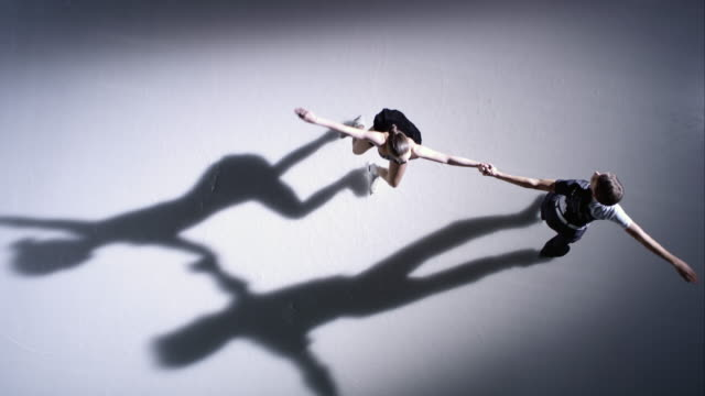SLO MO CS Figure skating pair holding hands and spinning video