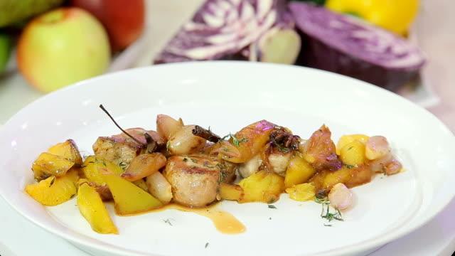 Fillet mignon garnished with stewed vegetables video