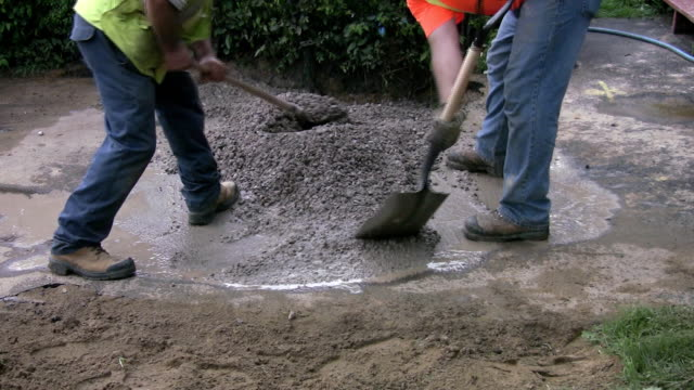 Filling a hole with cement. video