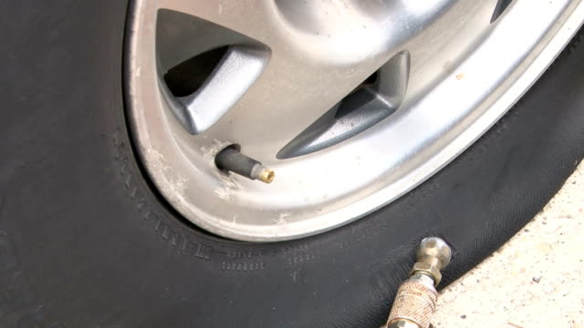 Filling Car Tire with Air video