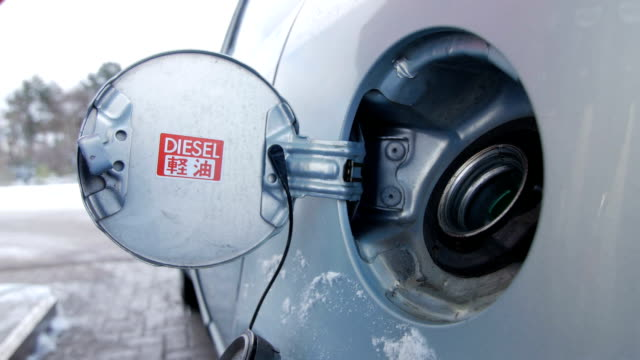 Filling car with gas fuel at station pump video