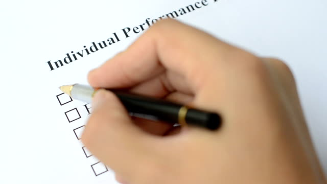 filling employee performance evaluation form video
