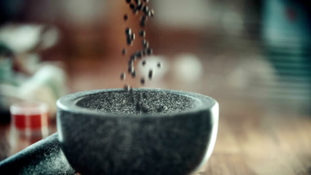 Filling Peppercorns into Mortar and Pestle video