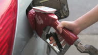 Filling up car gas tank with fuel at station. video