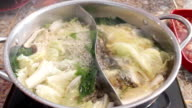 Filling variety meat to boiling shabu pot video