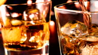 filling whiskey in the glass on table, whisky relax time concept video