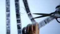 Film processing cutting 35mm black and white negatives video