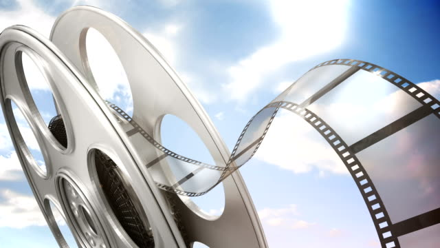 Film rolling out of a film reel video