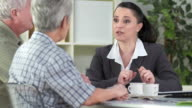 HD: Financial Advisor Talking With Senior Clients video