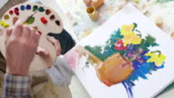 4К Fine artist painting in studio video