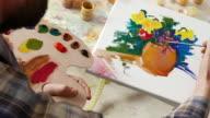 4К Fine artist painting in workshop video