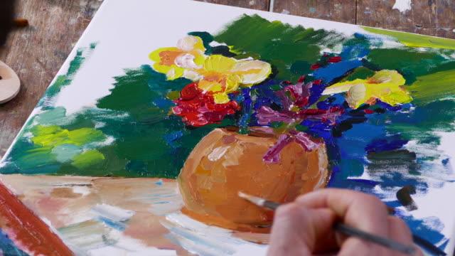 4К Fine artist painting vase with flowers video