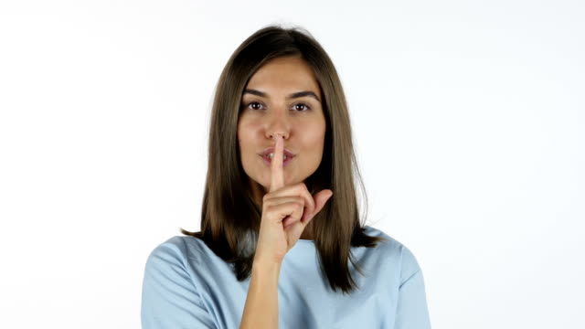 Finger on Lips, Silence Gesture by Beautiful Girl, White Background in Studio video